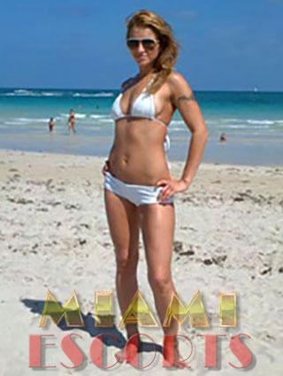 Miami top escorts love to pose on the beach.